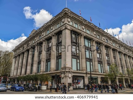 LONDON, ENGLAND - APRIL 17: Shoppers walking past the famous Selfridges Department Store on Oxford Street, central London on April 17 2016. The street is home to many fashion shops. - stock photo