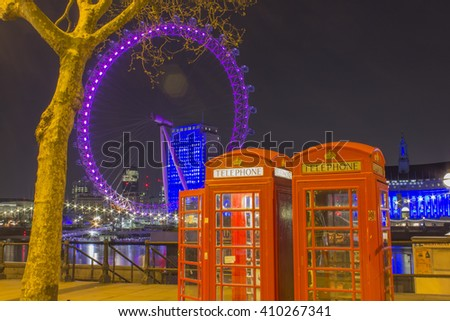London, England - April 8, 2016: Westminster's London Eye and buildings lit up with pink lights on the 8th of April 2016 in London, England.