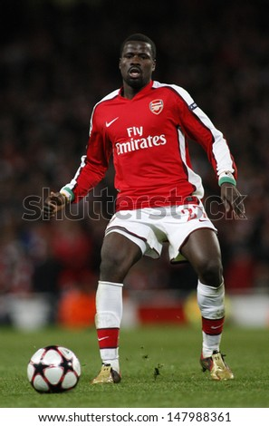 LONDON, ENGLAND. 31/03/2010. Arsenal player Emmanuel Ebou in action during the  UEFA Champions League quarter-final between Arsenal and Barcelona at the Emirates Stadium - stock photo