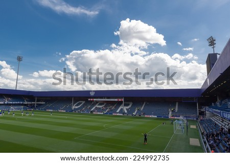 LONDON, ENGLAND - AUG 9, 2014 : Interior view of the empty Loftus Road Stadium before the friendly match QPR vs Paok. Loftus Road Stadium is the home base of the football team QPR. - stock photo