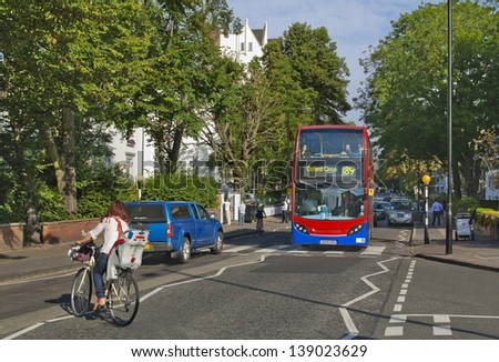 LONDON, ENGLAND - AUGUST 23: Famous crossroad on Abbey Road which gave a title and a cover for the Beatles� album in August 23, 2012 - stock photo