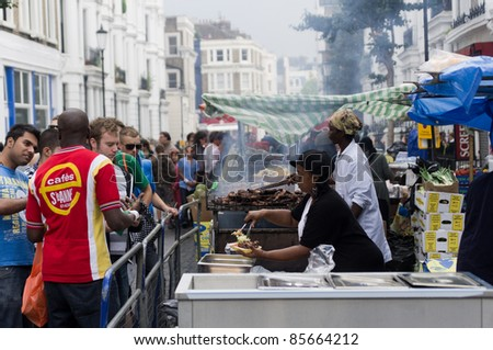 LONDON, ENGLAND - AUGUST 28: Food's stall at the Notting Hill Carnival on August 29, 2011 in London, England. - stock photo
