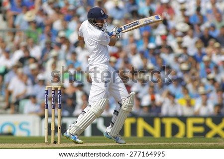 LONDON, ENGLAND - August 23: Joe Root plays a shot during day three of the 5th Investec Ashes cricket match between England and Australia played at The Kia Oval Cricket Ground  - stock photo