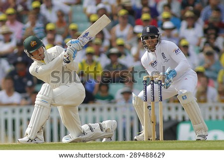 LONDON, ENGLAND - August 25:  Michael Clarke plays a shot as Matt Prior looks on during the Investec Ashes cricket match between England and Australia played at The Kia Oval Cricket - stock photo