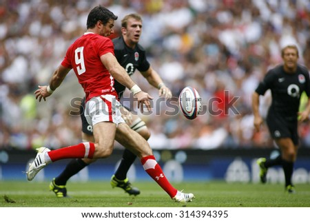 LONDON, ENGLAND. 06 AUGUST 2011. Mike Phillips, playing for Wales   in action during the rugby union Investec International between England and Wales at Twickenham Stadium. - stock photo