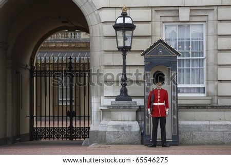 LONDON, ENGLAND - AUGUST 25: Sentry of the Grenadier Guards posted outside of Buckingham Palace on August 25, 2006 in London, United Kingdom.. - stock photo