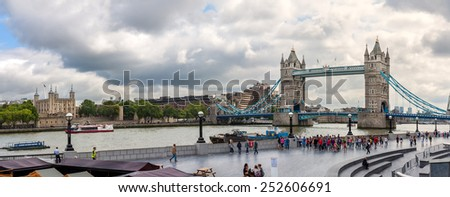 LONDON, ENGLAND - AUGUST 6: Tower Bridge from north bank  on August 6 2014 in London, England. One of the most recognizable bridges in the world designed by Horace Jones and John Wolfe Barry. - stock photo