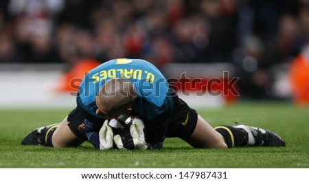 LONDON, ENGLAND. 31/03/2010.Barcelona goalkeeper Victor Valdes  in action during the  UEFA Champions League quarter-final between Arsenal and Barcelona at the Emirates Stadium - stock photo