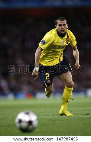 LONDON, ENGLAND. 31/03/2010. Barcelona player Dani Alves in action during the  UEFA Champions League quarter-final between Arsenal and Barcelona at the Emirates Stadium - stock photo