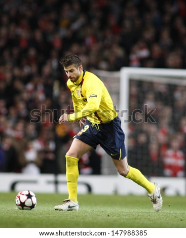 LONDON, ENGLAND. 31/03/2010. Barcelona player Gerard Piquet in action during the  UEFA Champions League quarter-final between Arsenal and Barcelona at the Emirates Stadium - stock photo