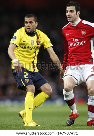LONDON, ENGLAND. 31/03/2010. Barcelona's Dani Alves and Arsenal player Cesc Fabregas in action during the  UEFA Champions League quarter-final between Arsenal and Barcelona at the Emirates Stadium - stock photo