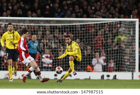 LONDON, ENGLAND. 31/03/2010. Barcelona's Pedro Rodraguez clears the ball as Arsenal's Samir Nasri rushes in, during the  UEFA Champions League quarter-final at the Emirates Stadium - stock photo