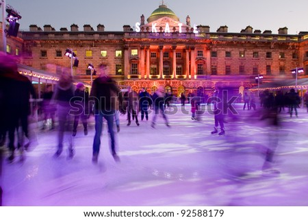 LONDON, ENGLAND - DEC 26: Beautiful Somerset house ice rink on December 26, 2011 in London, England.  Skate at Somerset House presented by Tiffany & Co. is opened until January 22 2012. - stock photo