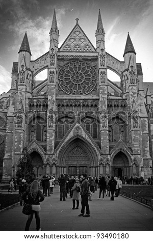 LONDON, ENGLAND - DEC 28: Black and white shot of Westminster Abbey with people in front on December 28, 2011 in London, England. Church where Prince William and Kate Middleton were married. - stock photo