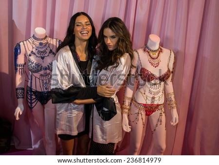 LONDON, ENGLAND - DECEMBER 02: Adriana Lima(L) and Alessandra Ambrosio (R) pose backstage at the annual Victoria's Secret fashion show on December 2, 2014 in London, England. - stock photo