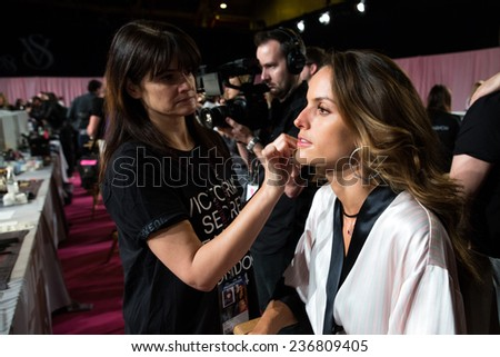 LONDON, ENGLAND - DECEMBER 02: Izabel Goulart poses backstage at the annual Victoria's Secret fashion show at Earls Court on December 2, 2014 in London, England. - stock photo