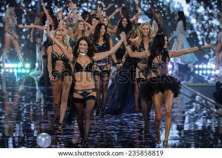 LONDON, ENGLAND - DECEMBER 02:  Models (L-R) Lily Aldridge, Candice Swanepoel, Doutzen Kroes, Alessandra Ambrosio and Adriana Lima on runway during 2014 VS Show on December 2, 2014 in London, England. - stock photo