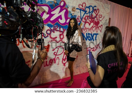 LONDON, ENGLAND - DECEMBER 02: Official TV crew shooting Adriana Lima backstage at the annual Victoria's Secret fashion show at Earls Court on December 2, 2014 in London, England.