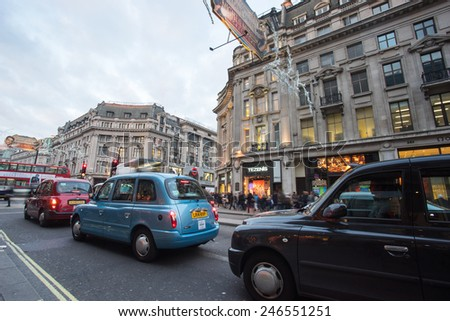 LONDON, ENGLAND  DECEMBER 30, 2014: Oxford street on sale season after Christmas. This street is a major shopping street of London.