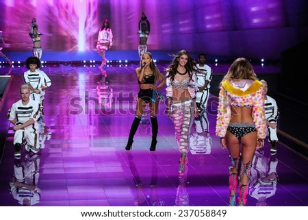 LONDON, ENGLAND - DECEMBER 02: Singer Ariana Grande performs as Model Taylor Hill walks the runway during Victoria's Secret fashion show on December 2, 2014 in London, England. - stock photo