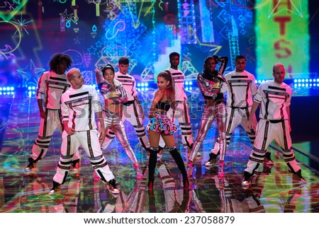 LONDON, ENGLAND - DECEMBER 02: Singer Ariana Grande performs at the annual Victoria's Secret fashion show on December 2, 2014 in London, England. - stock photo