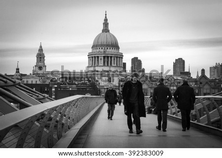 LONDON, ENGLAND - DECEMBER 12, 2015: The floodlit exterior of London's St Paul's Cathedral makes it a popular draw-card for the city residents as well as hundreds of tourists every day.