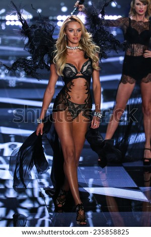 LONDON, ENGLAND - DECEMBER 02: Victoria's Secret model Candice Swanepoel walks the runway during the 2014 Victoria's Secret Fashion Show on December 2, 2014 in London, England. - stock photo
