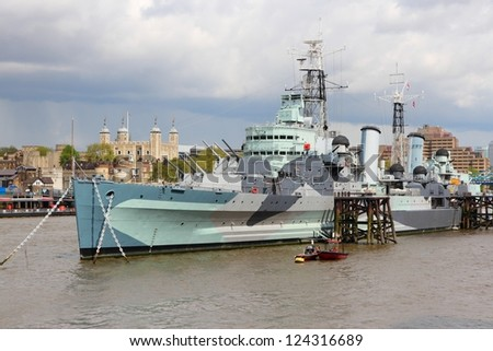 London, England - famous historic ship, HMS Belfast. Light cruiser navy vessel moored in Thames River. - stock photo