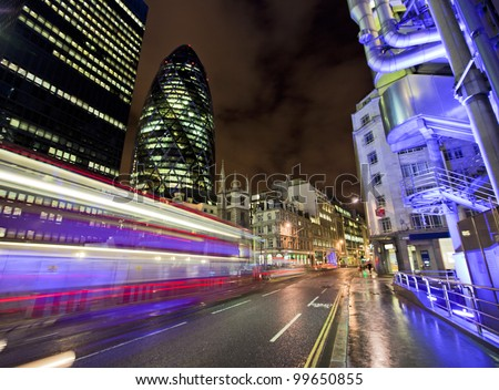 LONDON, ENGLAND FEB 13: Famous Gherkin building and Lloyds Building on Feb 13, 2012 in London, United Kingdom. - stock photo