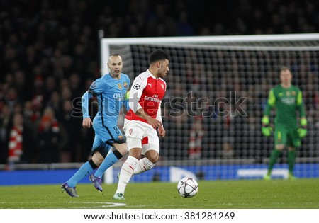 LONDON, ENGLAND - FEBRUARY 23: Andres Iniesta of Barcelona and Alex Oxlade-Chamberlain of Arsenal during the Champions League match between Arsenal and Barcelona at The Emirates Stadium  - stock photo