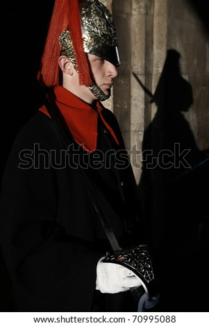 LONDON, ENGLAND - FEBRUARY 21: Member of the Royal Horse Guards on sentry in front of the palace in February 21, 2009 in London, United Kingdom. - stock photo