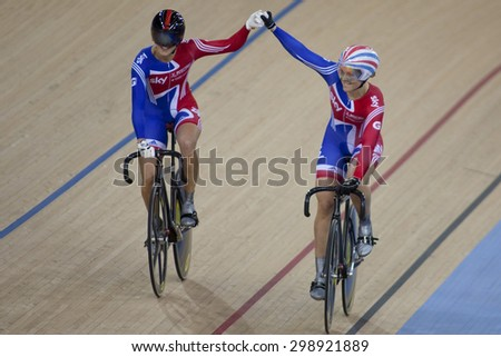 LONDON, ENGLAND. FEBRUARY 18 2012:  Victoria Pendleton (GBR) and Jess Varnish (GBR) in action during the UCI Track Cycling World Cup at the London Olympic Velodrome, Queen Elizabeth 2nd Park - stock photo