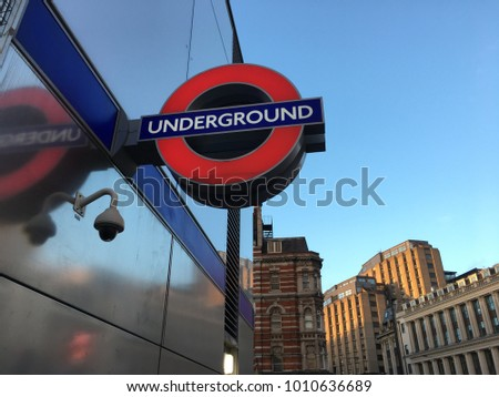 London,England,Friday 19th January 2018 , the Tottenham Court Road underground sign outside the tube station in a beautiful weather blue sky day Londoner metropolitan life style