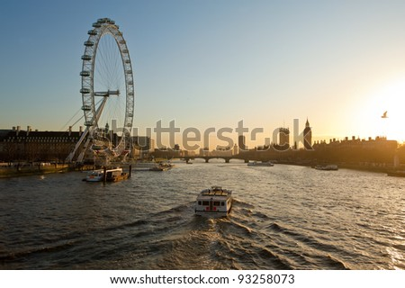 LONDON, ENGLAND - JAN 14: London eye on a sunny day on January 14, 2012 in London, England. This is the highest Ferris wheel in Europe (135m) - stock photo