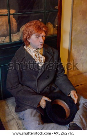 LONDON, ENGLAND - JUL 22, 2016: Characters from the stories at the Sherlock Holmes Museum, 221 Baker Street, London. Sherlock Holmes  is a fictional private detective created by Sir Arthur Conan Doyle