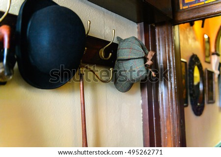 LONDON, ENGLAND - JUL 22, 2016: Hat at the Sherlock Holmes Museum, 221 Baker Street, London. Sherlock Holmes  is a fictional private detective created by Sir Arthur Conan Doyle