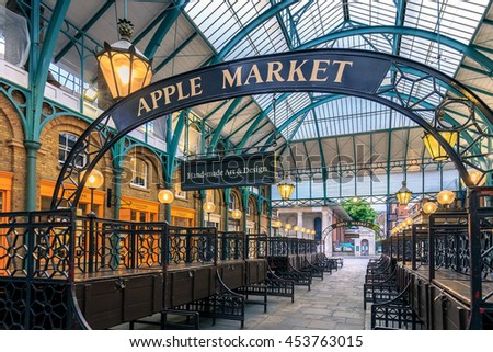 """LONDON, ENGLAND - JULY 16, 2016. A Sign """"apple market"""" in Covent Garden, London. The Apple Market is sells arts and crafts dedicated to antiques and collectables items. - stock photo"""