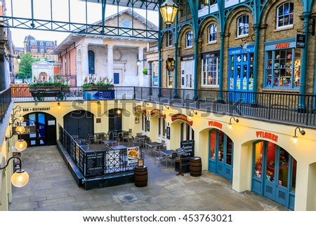 LONDON, ENGLAND - JULY 16, 2016.  Apple Market in Covent Garden in London, UK. The Apple Market is sells arts and crafts dedicated to antiques and collectables items. - stock photo