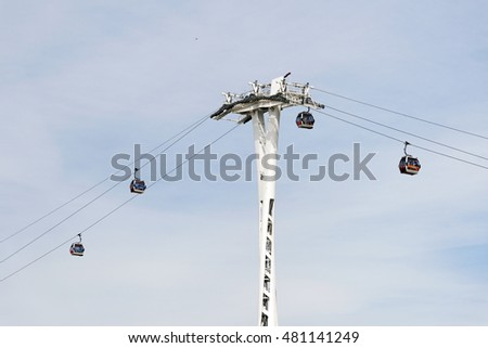 LONDON, ENGLAND - JULY 7, 2016: Emirates Air Line cable cars. The service is the UK's first urban cable car running across the Thames from the O2 to the Excel Center.