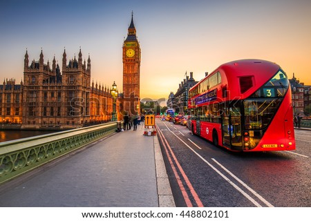 LONDON, ENGLAND - JULY 03,2016. London scenery at Westminter bridge with Big Ben and at sunset blurred red bus, UK.