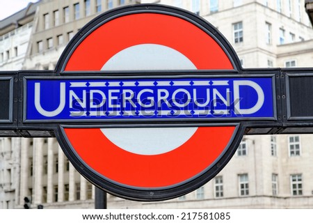 LONDON, ENGLAND - JULY 1, 2014: London Underground sign. The London Underground is the oldest underground railway in the world covering 402 km of tracks - stock photo
