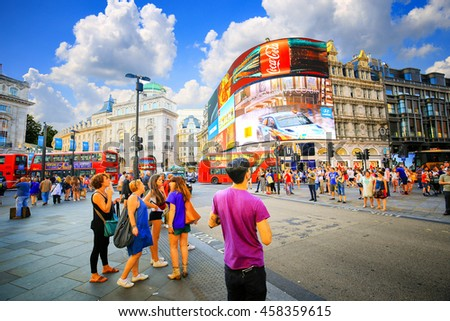 LONDON, ENGLAND - JULY 03, 2016. People and traffic in Picadilly Circus in London.A famous public space in London's West End, it was built in 1819.  - stock photo