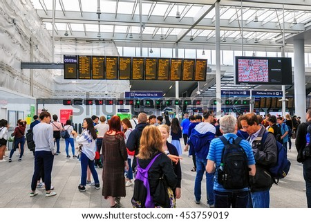 LONDON, ENGLAND - JULY 16, 2016.  People at Liverpool Street station. Opened in 1874 it is third busiest and one of the main railway stations in UK, with connection to London Underground. - stock photo