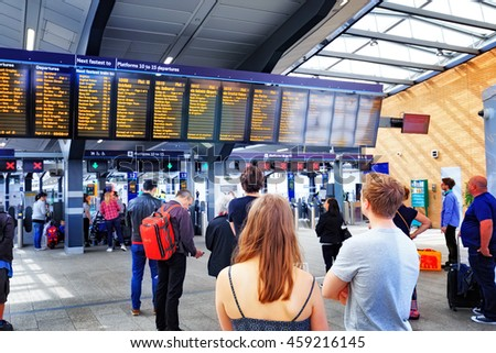 LONDON, ENGLAND - JULY 16, 2016. People at Liverpool Street station. Opened in 1874 it is third busiest and one of the main railway stations in UK, with connection to London Underground - stock photo