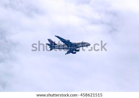 LONDON, ENGLAND - JULY 8, 2016: Qatar Airways commercial passenger jet approaching London Heathrow International Airport to make a landing. - stock photo