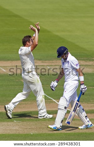 LONDON, ENGLAND - July 18 2013: Ryan Harris celebrates taking the wicket of Joe Root on day one of the Investec Ashes 2nd test match, at Lords Cricket Ground on July 18, 2013 in London, England.
