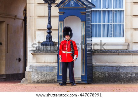 LONDON, ENGLAND- JULY 03 :2016: Sentry of the Grenadier Guards posted outside of Buckingham Palace on July in London, United Kingdom. The Grenadier Guards traces its lineage back to 1656. - stock photo