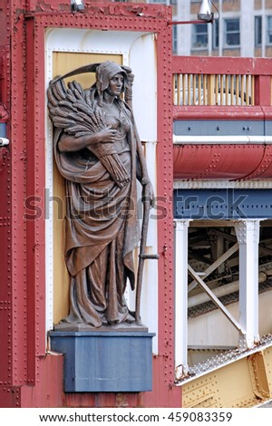 LONDON, ENGLAND - JULY 8, 2016: Statue representing Agriculture on a pier of Vauxhall Bridge over the River Thames in London. Sculpted by the late Frederick Pomeroy and on permanent public display. - stock photo