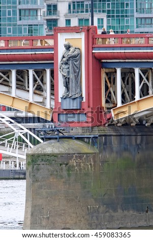 LONDON, ENGLAND - JULY 8, 2016: Statue representing Local Government on a pier of Vauxhall Bridge over the River Thames in London. Sculpted by the late Alfred Drury and on permanent public display. - stock photo