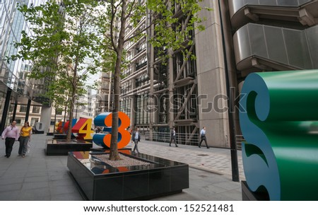 LONDON, ENGLAND - JULY 16, 2013: street art, large numerals in Lime Street, in the finance district of London, on July 16, 2013. Striking brightly coloured numbers add to the ambience of the street.